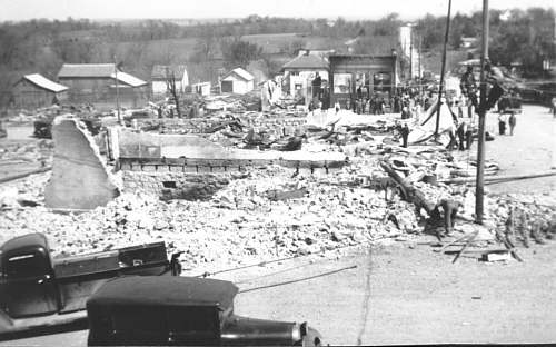 The brick building to the right of center is the one and only bank Iberia had.  The vault can be seen in the back left hand corner of the building.  At the back of the bank on Main Street, a garage and dentist's office burned.